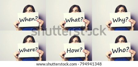 Girl holding a signboard with a question mark