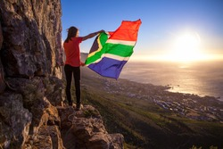 Girl holding a South African flag