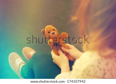 Girl holding a teddy bear