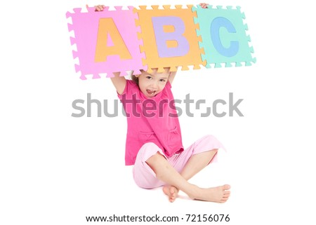 Girl holding alphabet abc sign above her head. Isolated on white.