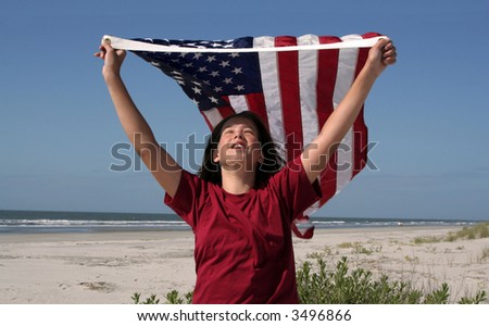 girl holding an American flag