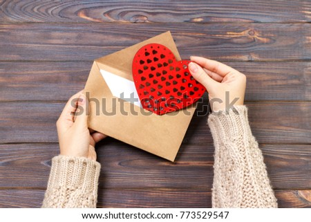 girl holding an envelope with valentine hearts. Valentine day concept with copyspace. #773529547