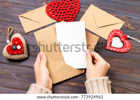 girl holding an envelope with valentine hearts. Valentine day concept with copyspace. #773924962