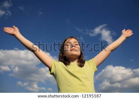 Girl Holding Arms up in Praise