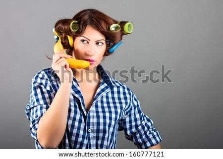 girl holding banana like cell phone