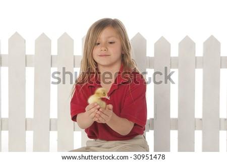 Girl holding ducklings