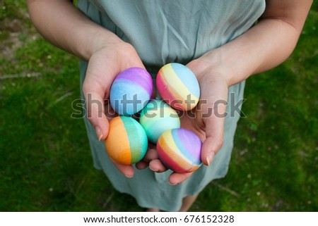 girl holding Easter eggs #676152328