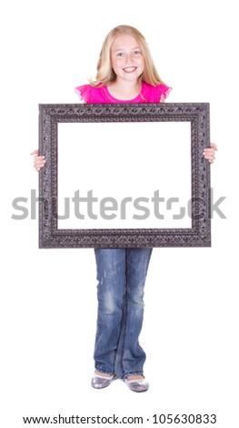 Girl holding large blank frame, isolated on white