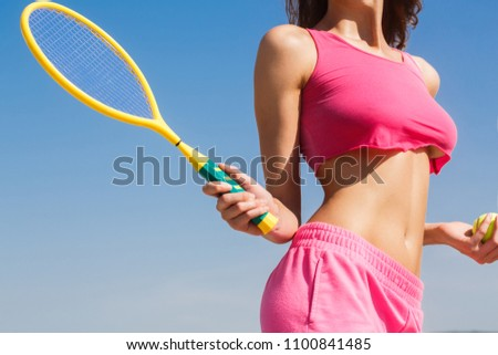Girl holding racket. Sexy tennis girl. Female tennis player with racket. Healthy lifestyle concept. Of beautiful athletic girl in stylish sportswear holding racket in hand, to play tennis outdoors