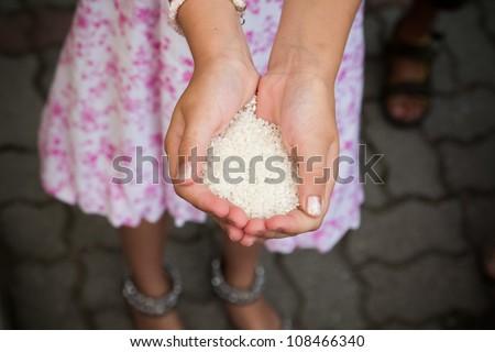 Girl holding rice
