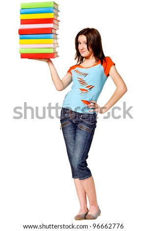 Girl holding stack color books. Isolated over white
