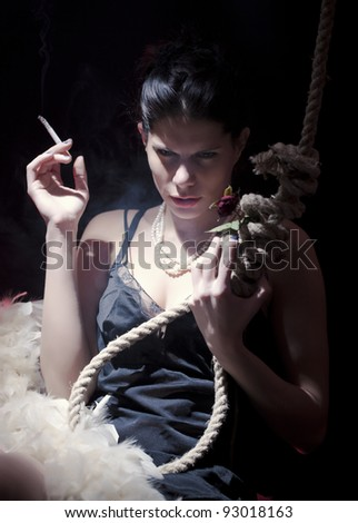 Girl holding the cigarette in one hand and rope with rose  in other/Suicide Thoughts