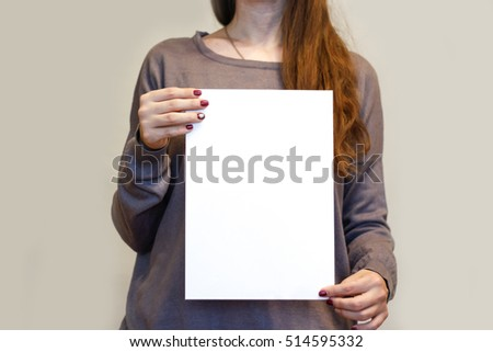 Girl holding white A4 blank paper vertically. Leaflet presentation. Pamphlet hold hands. Woman show clear offset paper. Booklet design sheet display read first person. #514595332