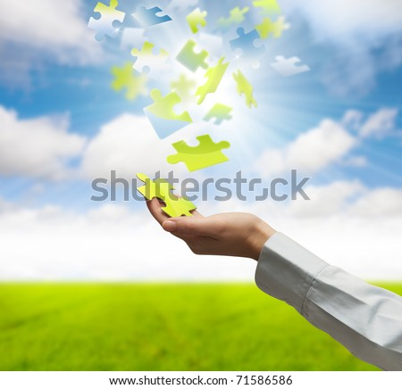 Girl holds a puzzle piece of nature - stock photo