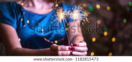 girl holds bengal lights - happy christmas and merry holidays #1182815473