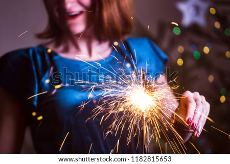 girl holds bengal lights - happy christmas and merry holidays #1182815653