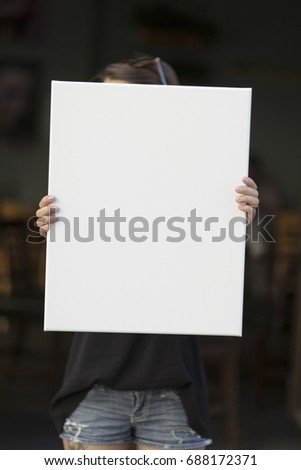 Girl holds canvas background for graphic presentation #688172371