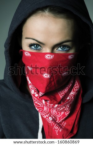 Girl hood and red scarf covered face stock photo 160860869