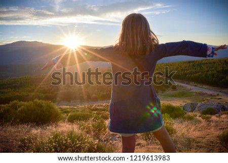 Girl hugging a sunset. Serenity and peace #1219613983