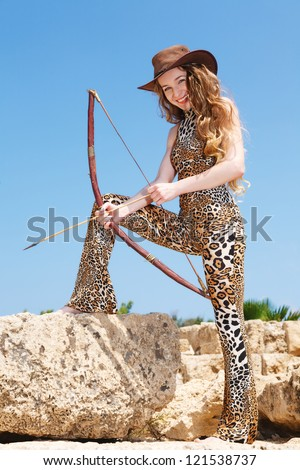 Girl hunting with a bow