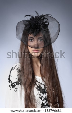 girl in a beautiful black hat with feathers