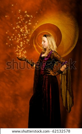 girl in a beautiful gothic dress with stars above her hand