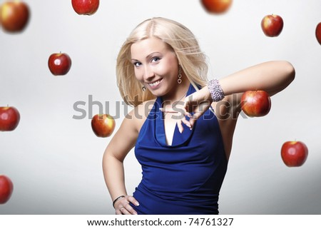 girl in a blue dress with red apples