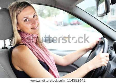 Girl in a car on a driver's place