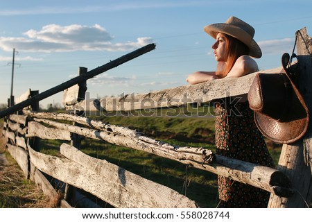girl in a cowboy hat in a field