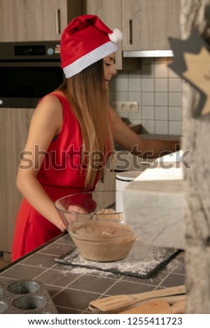 girl in a festive outfit, prepares a cake for baked goods