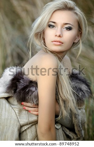 girl in a fur coat in the autumn background