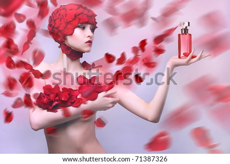 Girl in a gown of rose petals