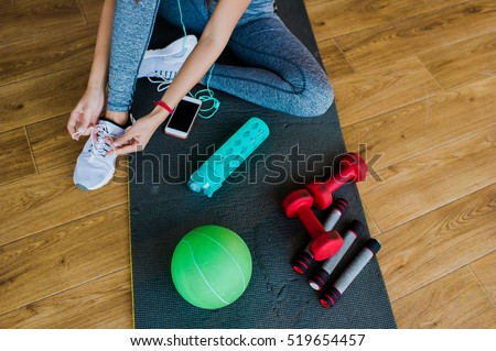 girl in a gym, sports equipment and telephone #519654457