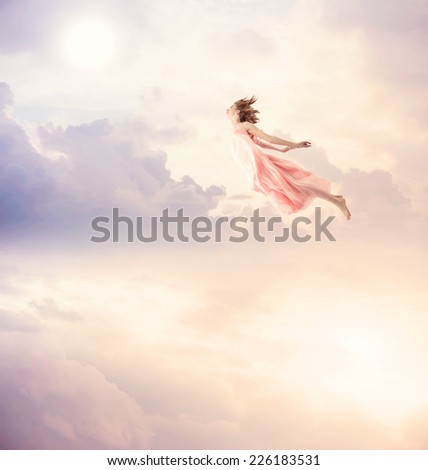 Girl in a pink dress flying in the sky. Serenity. #226183531