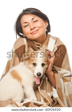 Girl in a plaid with a puppy