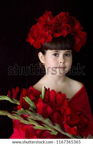 Girl in a red wreath. Wreath of gladiolus. The image of Frida Kahlo. The image of a girl on Halloween. Happy Halloween trick or treat