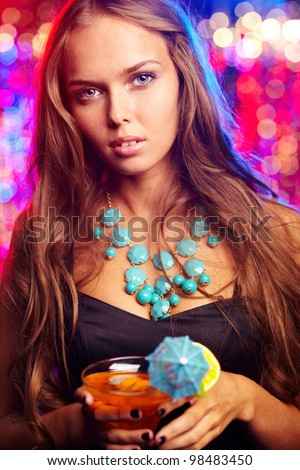 Girl in a stylish outfit spending time at a party