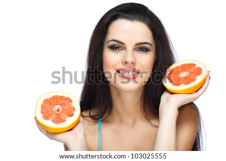 Girl in a turquoise swimming suit with a pink grapefruit, isolated on a white background, emotions
