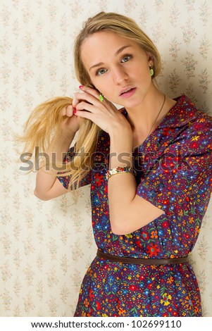girl in a vintage dress braids hair
