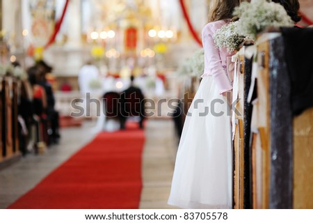 Girl in a white dress watching wedding ceremony