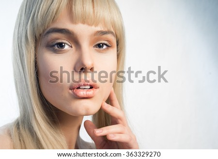 Stock Photo Girl in a white wig, close-up