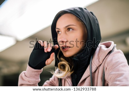 Girl in active wear. Athlete wears a hood. #1362933788