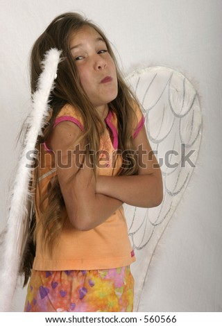 Girl in angel wings making face