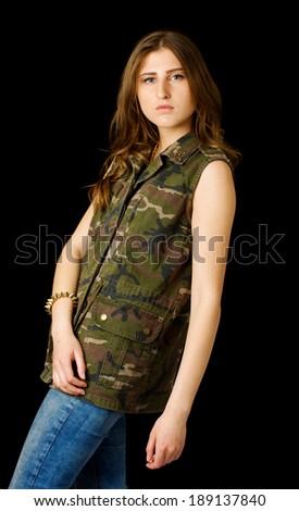 Girl in army jacket posing