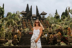 girl in balinese temple. Indonesia. Bali. The Temple Of Pura Besakih. Pura Besakih located on the slope of the mountain, where supposedly live the spirits friendly to man, who prayed in this temple.G