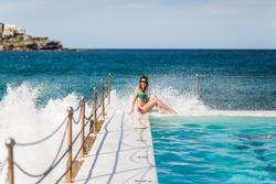 girl in bikini on city ocean coast bondi pool in sydney