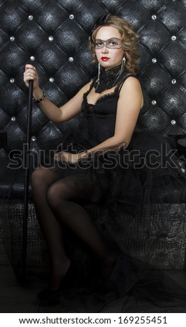 7c5ea176d Girl in black dress with a black bow and painted black mask on eyes  #169255451
