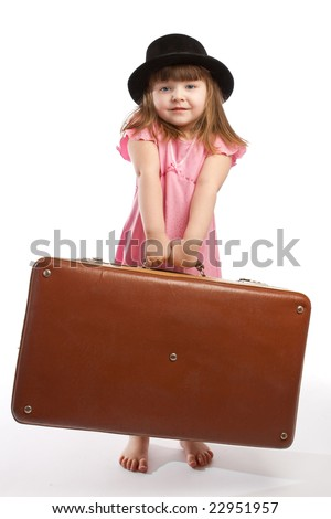 Girl in black hat carrying old suitcase