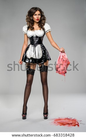 Girl in black latex dress removes blood