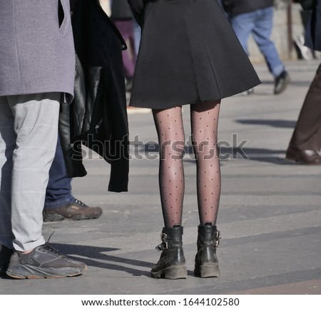 Girl in black pantyhose and miniskirt